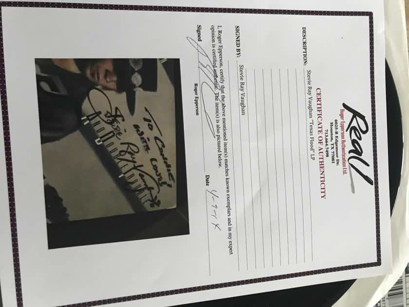 Stevie Ray Vaughan signed autographed Texas Flood lp Roger Epperson authenticated signature
