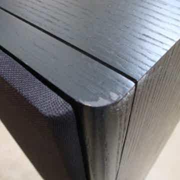 Small rub on upper front corner of one speaker