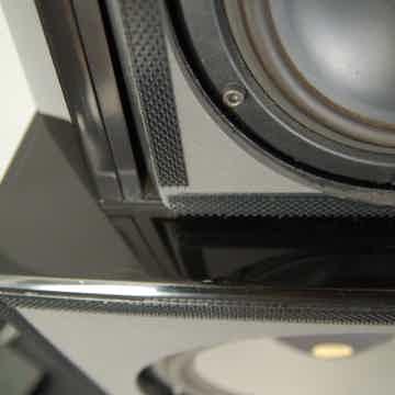 Small white mark on left speaker