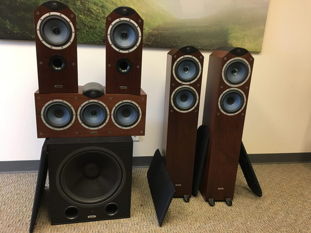 All speakers with cloth-covered grilles removed reveal the Dual Concentric Drivers