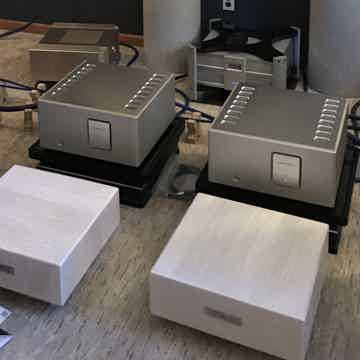 Luxman M800A amps (sitting behind custom SRA flagship amp stands)