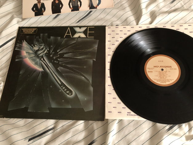 Axe Curb/MCA Records