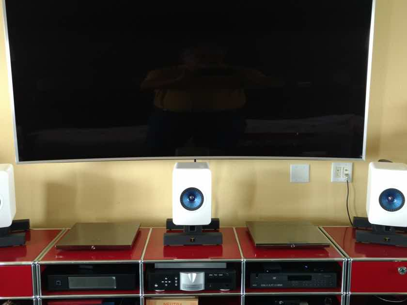 KEF LS50 White with 2 white JL Audio E112