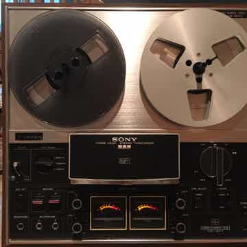Tape Deck shown in upright orientation with included take-up reels