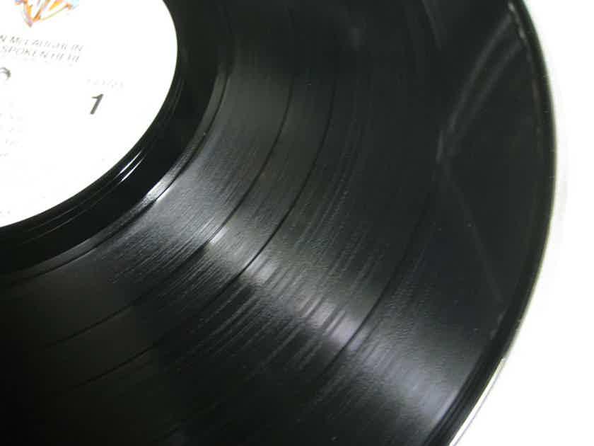 John McLaughlin - Music Spoken Here - 1983 Warner Bros. Records 9 23723-1